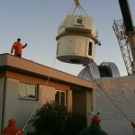 Lifting the telescope base into the dome
